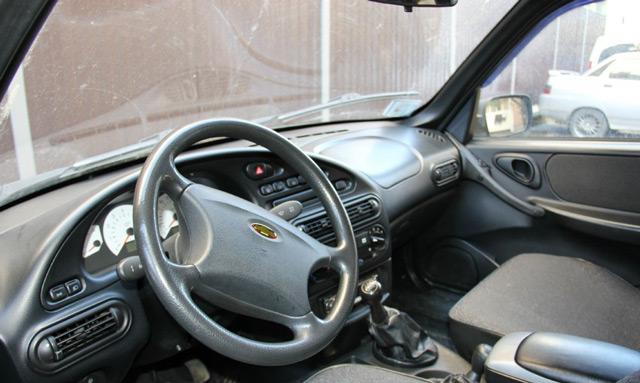 В салоне автомобиляВАЗ 2123 Chevrolet